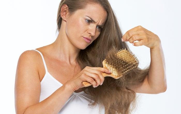 håravfall kvinna orsak