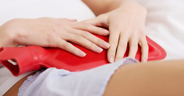 smärta innan mens